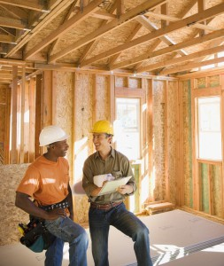 Foreman and construction worker reviewing work plans